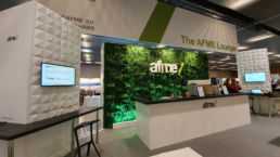 An exhibition stand with a living plant wall at an event