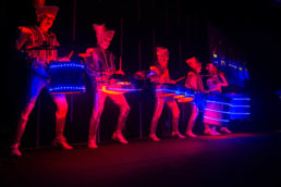 Illuminated performers at an awards ceremony at Battersea Evolution in London