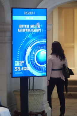 A digital sign for a conference at the Landmark Hotel, London