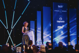 Presenter on awards ceremony stage at a corporate gala dinner event