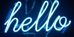 A blue neon hello sign