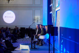 A panel of speakers onstage at the Landmark Hotel London